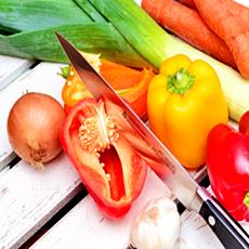 fresh vegetables and a knife, ready for cooking