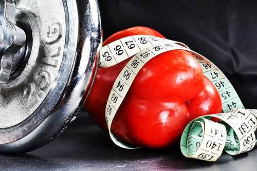 dumbbell, red pepper and tape measure: diet and exercise to lose weight