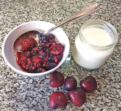 plain yogurt, berries and cherries for a natural and healthy breakfast
