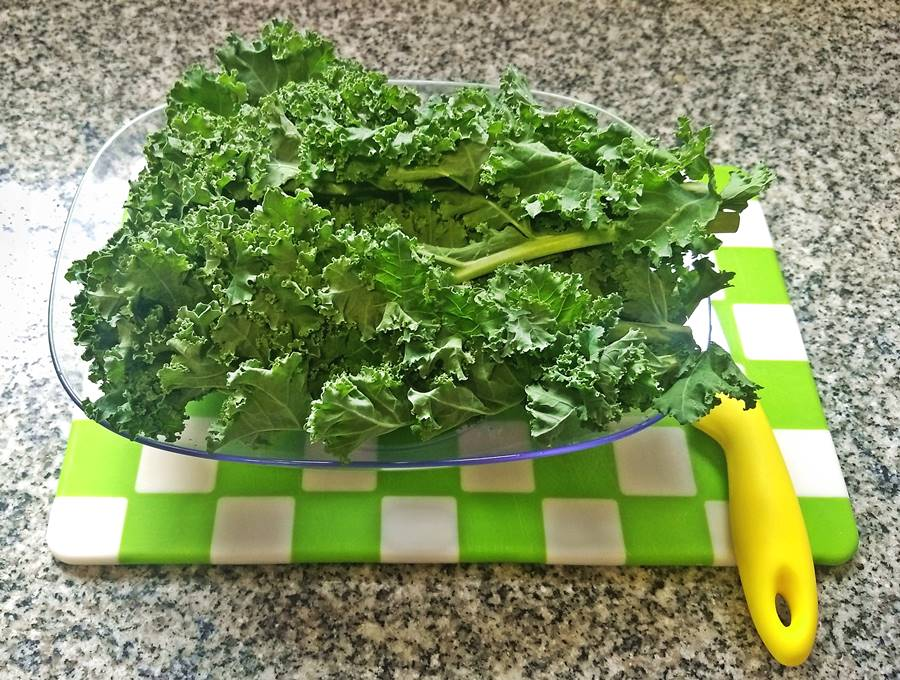raw kale on a chopping board