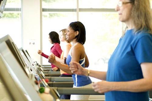 women jogging on treadmill