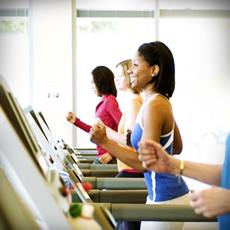 women jogging on treadmill