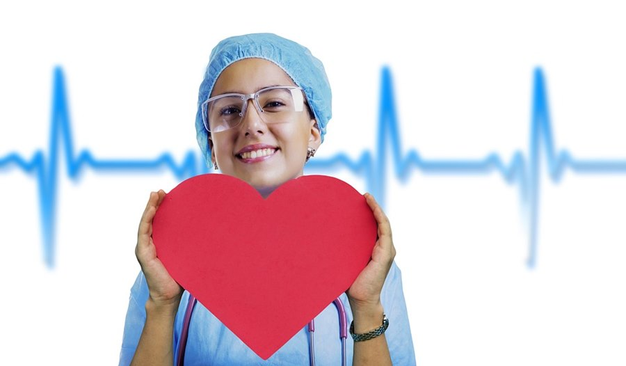 nurse holding a paper heart