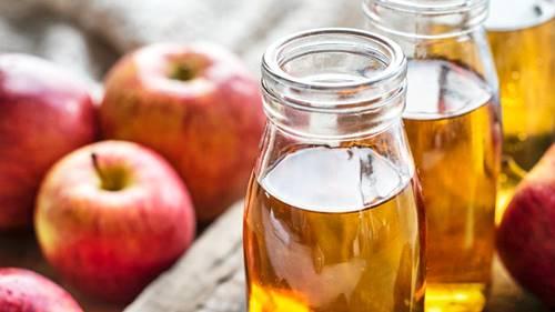 apples and bottles of apple cider vinegar