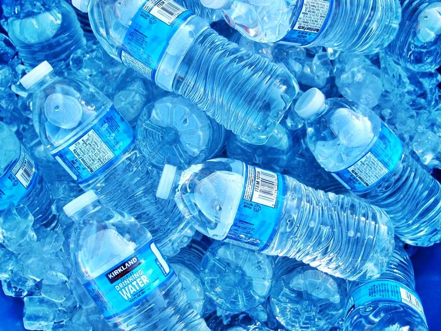 plastic water bottles on ice