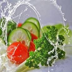 water and fresh vegetables: allegory of low calorie diet