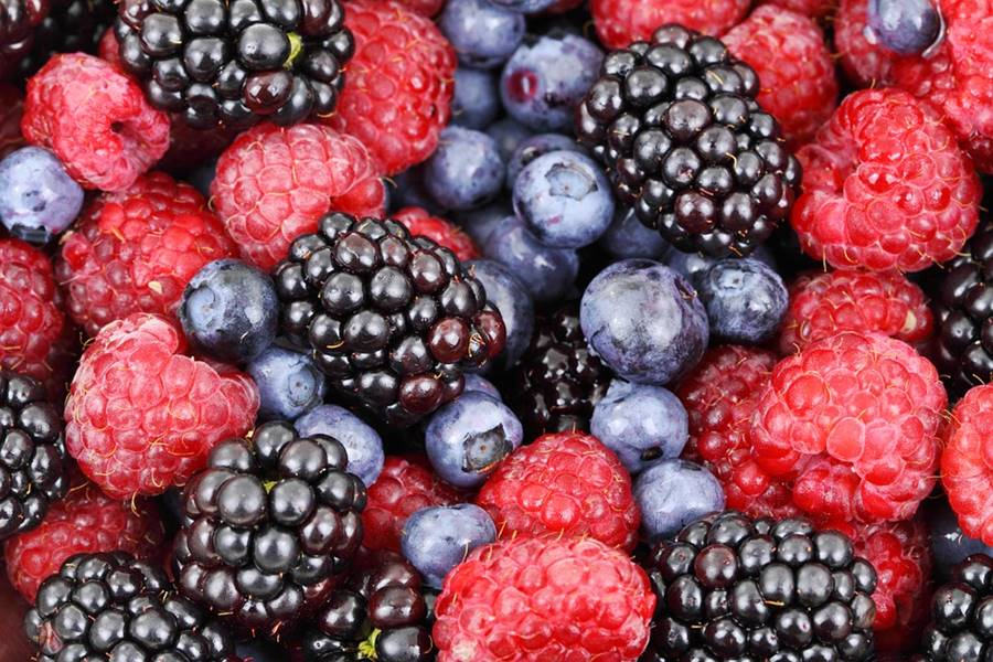 a mix of different types of berries
