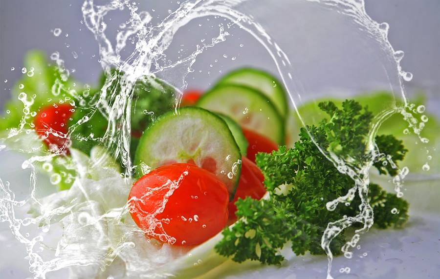 cucumbers, tomatos and splashing water