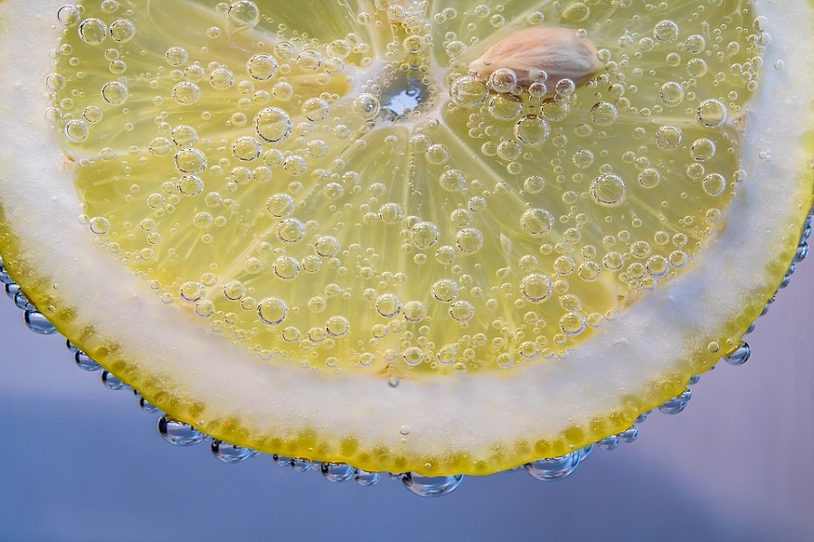 Zesty slice of lemon in water