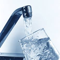 tap filling glass with water