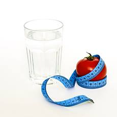 a glass of water, a tomato and weight loss