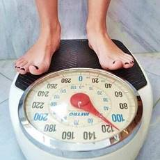 woman's feet on a weighing scale