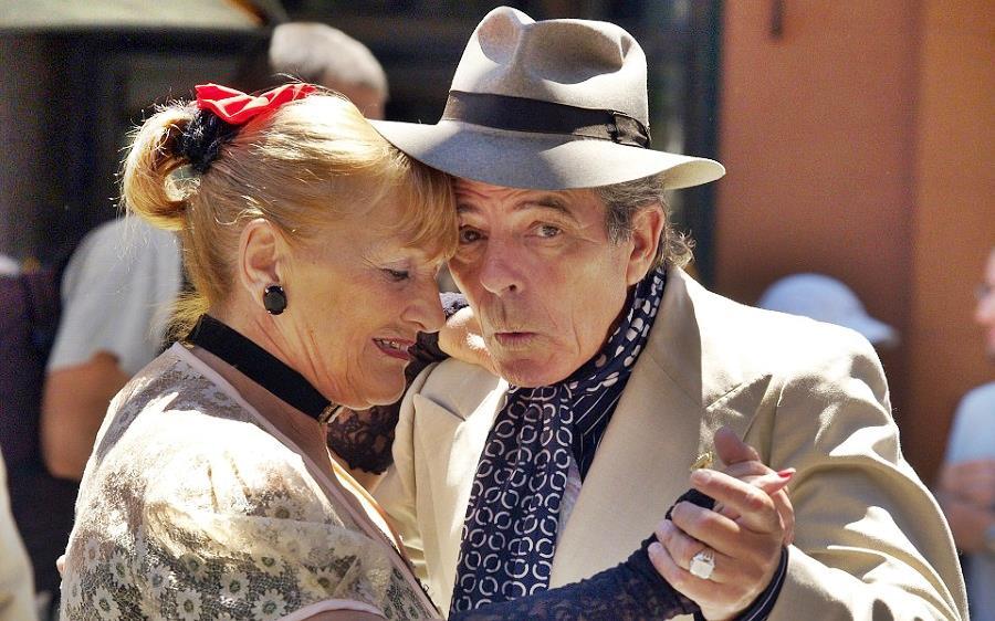 Senior couple having fun dancing tango