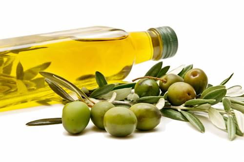 bottle with olive oils and some fresh olives