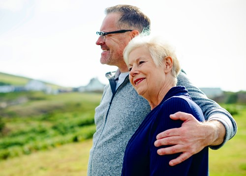 A smiling older couple, man and woman